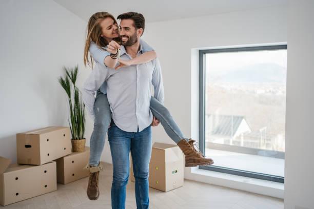 Cheerful couple enjoying their new home stock photo