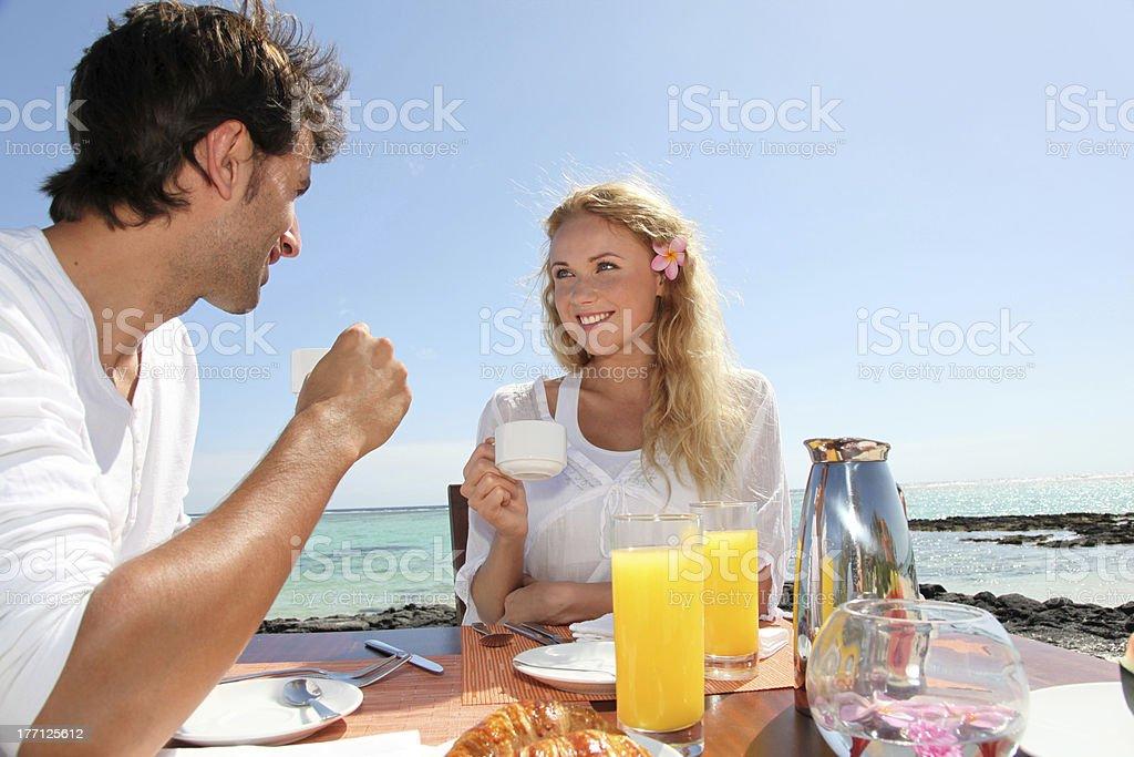 Cheerful couple having breakfast royalty-free stock photo