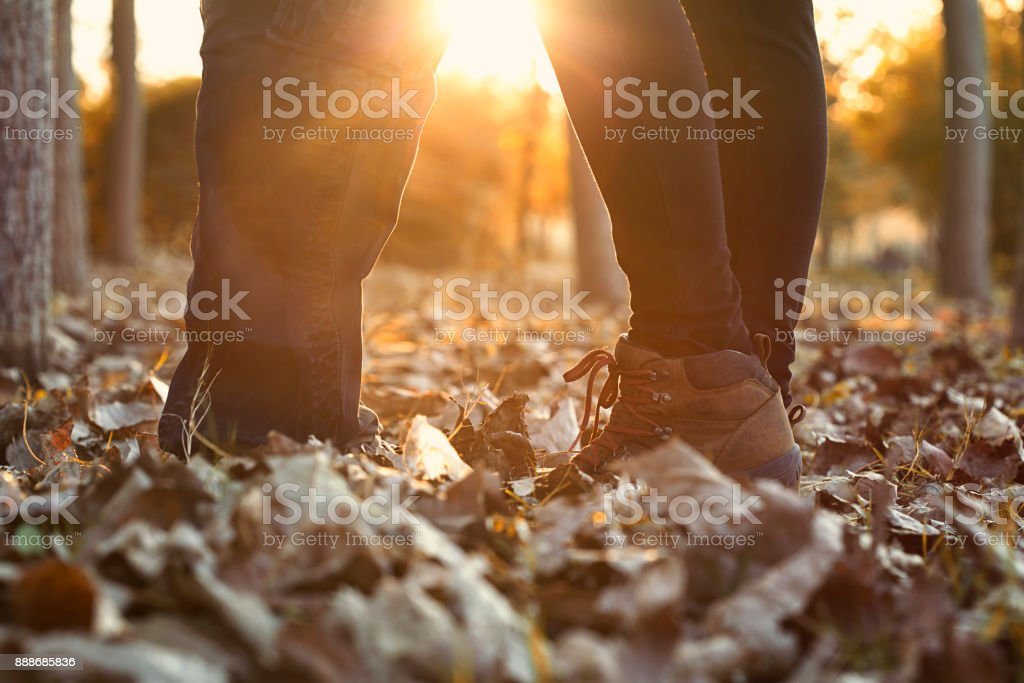 Cheerful couple having fun together during autumn day stock photo