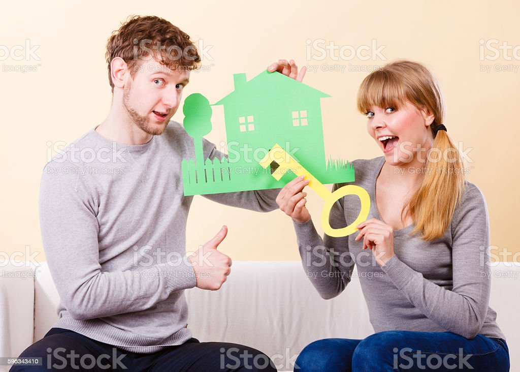 Cheerful couple holding cutouts. royalty-free stock photo