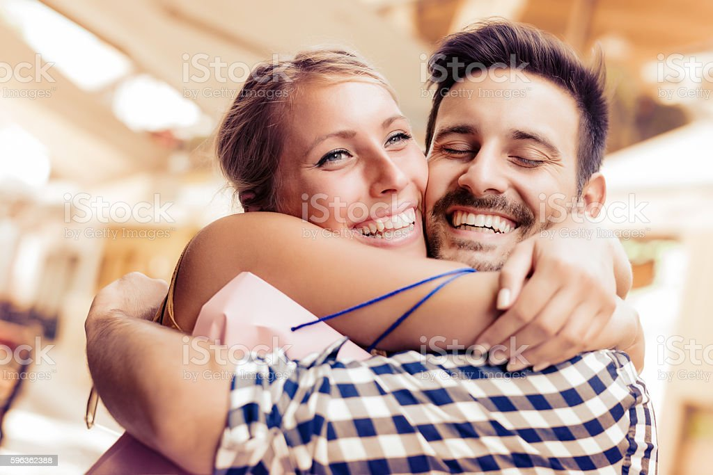 Cheerful couple in shopping royalty-free stock photo