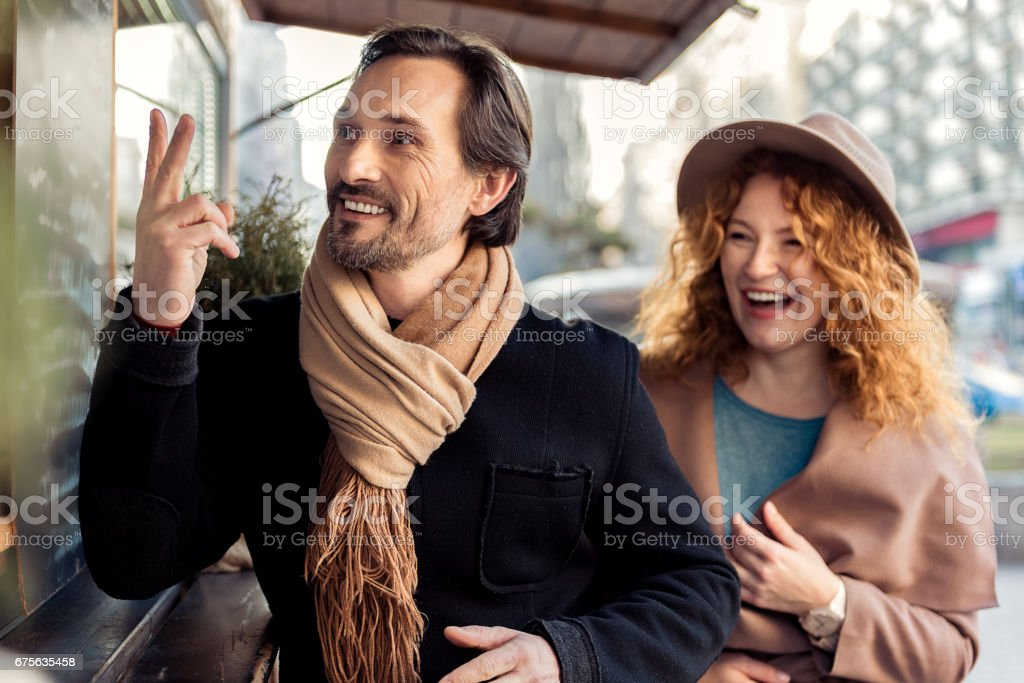 Cheerful couple is ready to drink something on street royalty-free stock photo