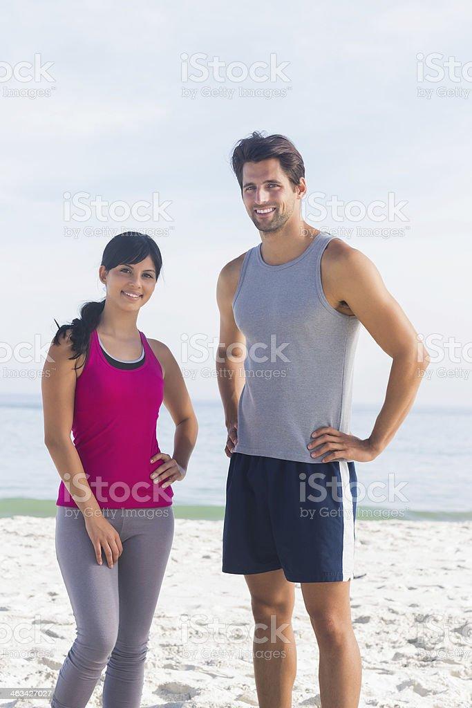 Cheerful couple of joggers having a break royalty-free stock photo