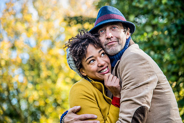 Cheerful couple Happy couple enjoying outdoors in park in autumn. age contrast stock pictures, royalty-free photos & images