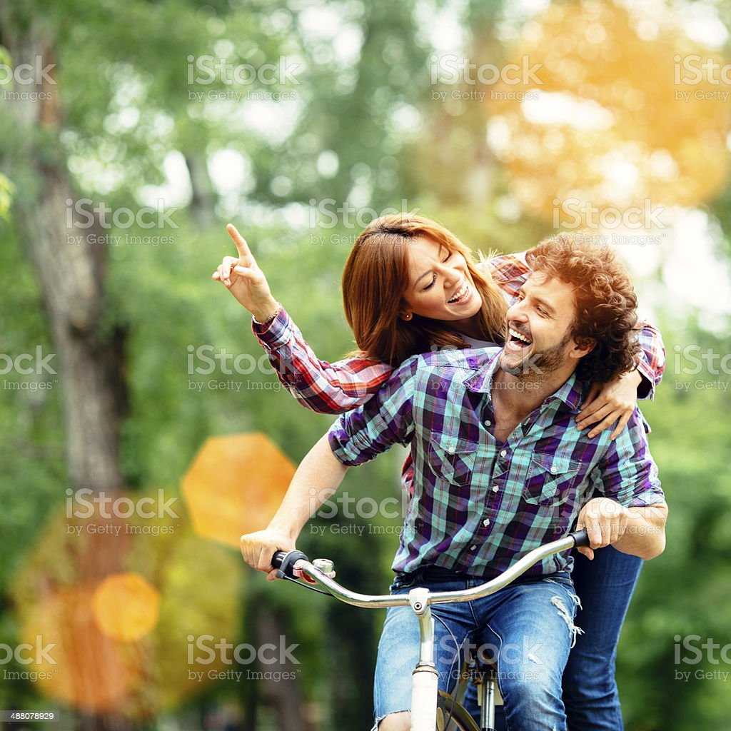 Cheerful Couple Riding Bicycle Together. royalty-free stock photo
