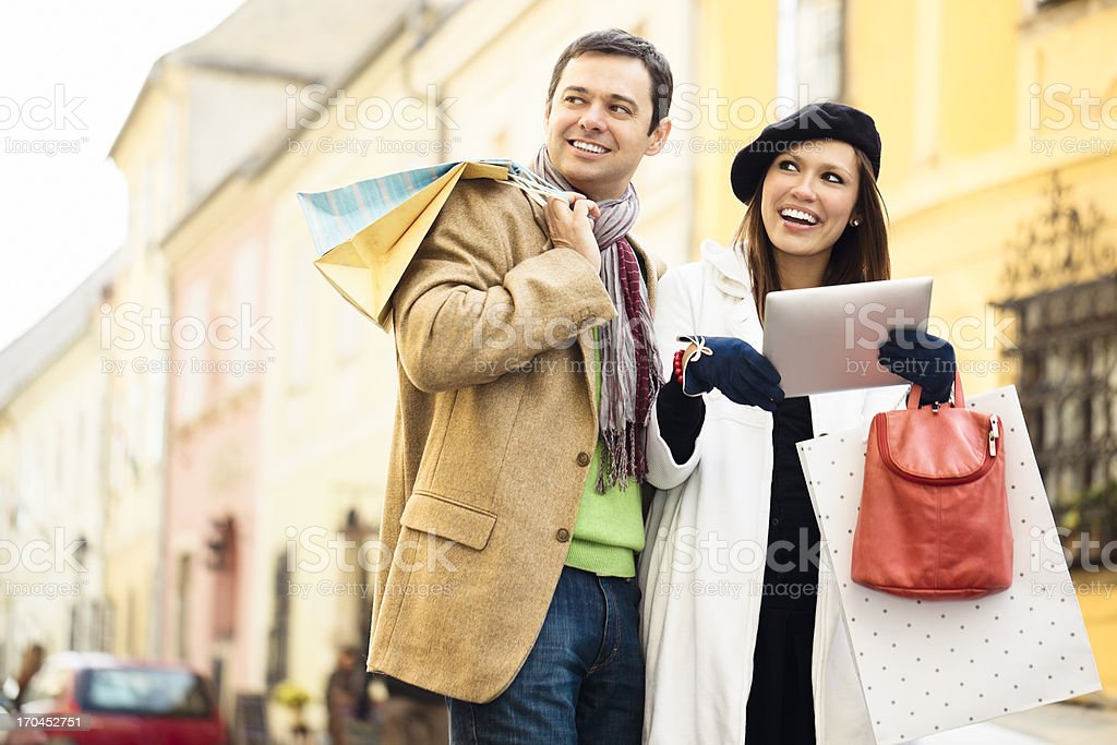 Cheerful couple shopping together royalty-free stock photo