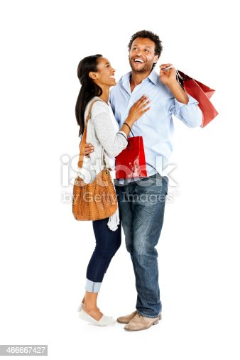 istock Cheerful couple standing together with shopping bags 466667427