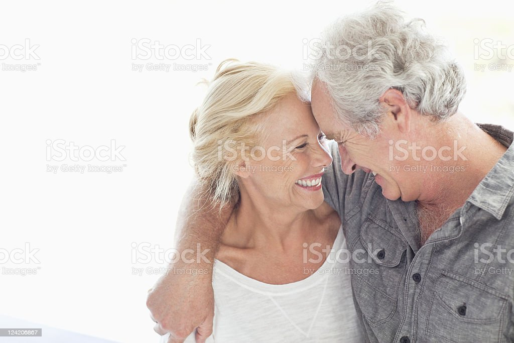 Cheerful couple staring at each other and smiling stock photo