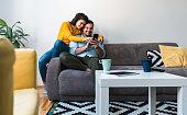 istock Cheerful couple using mobile phone stock photo 1253318148