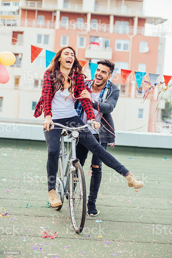 Cheerful couple with a bicycle stock photo