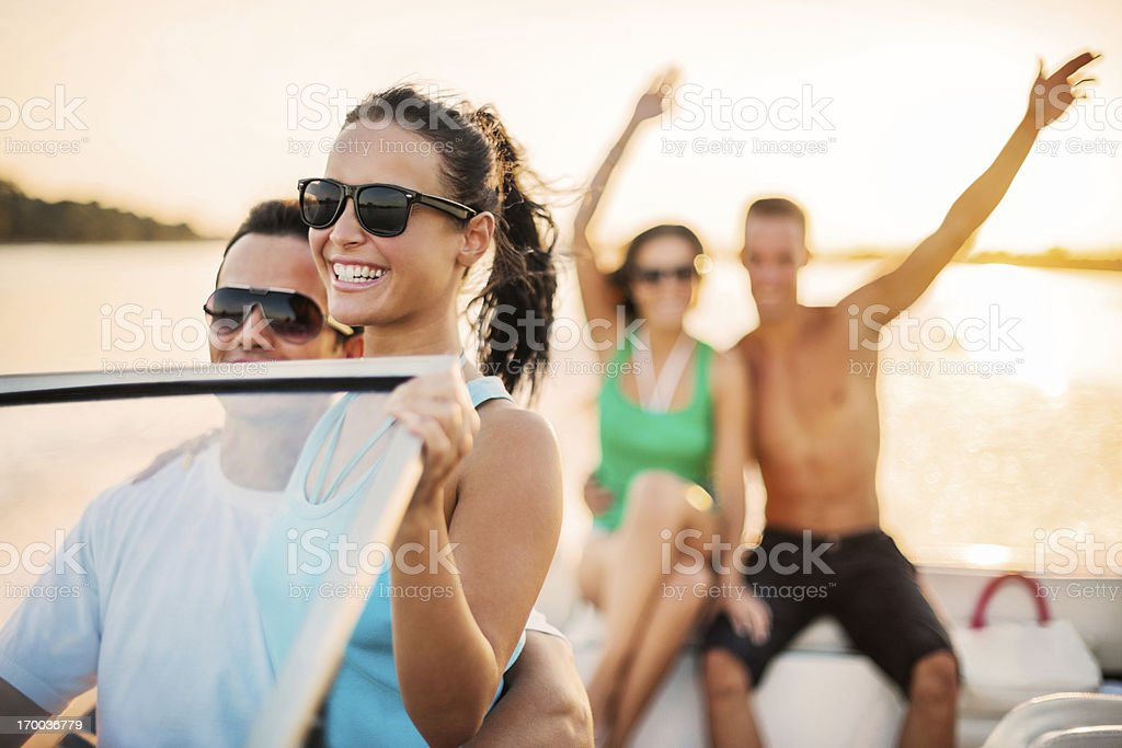 Cheerful couples enjoying on a speedboat ride. royalty-free stock photo