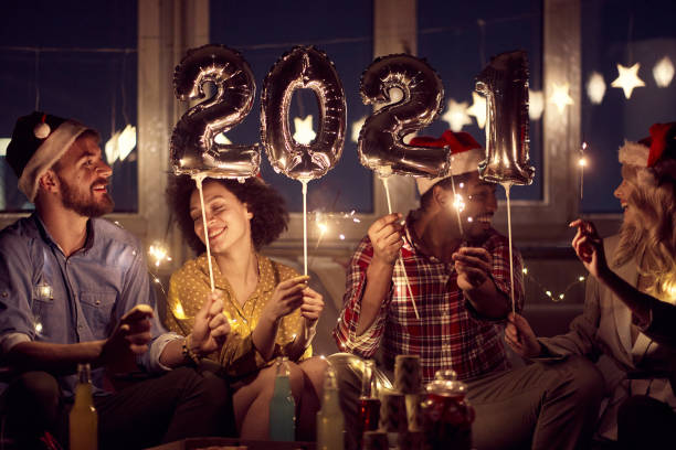 Cheerful couples having good time together at New Year eve home party. New Year, home party, friends time together stock photo
