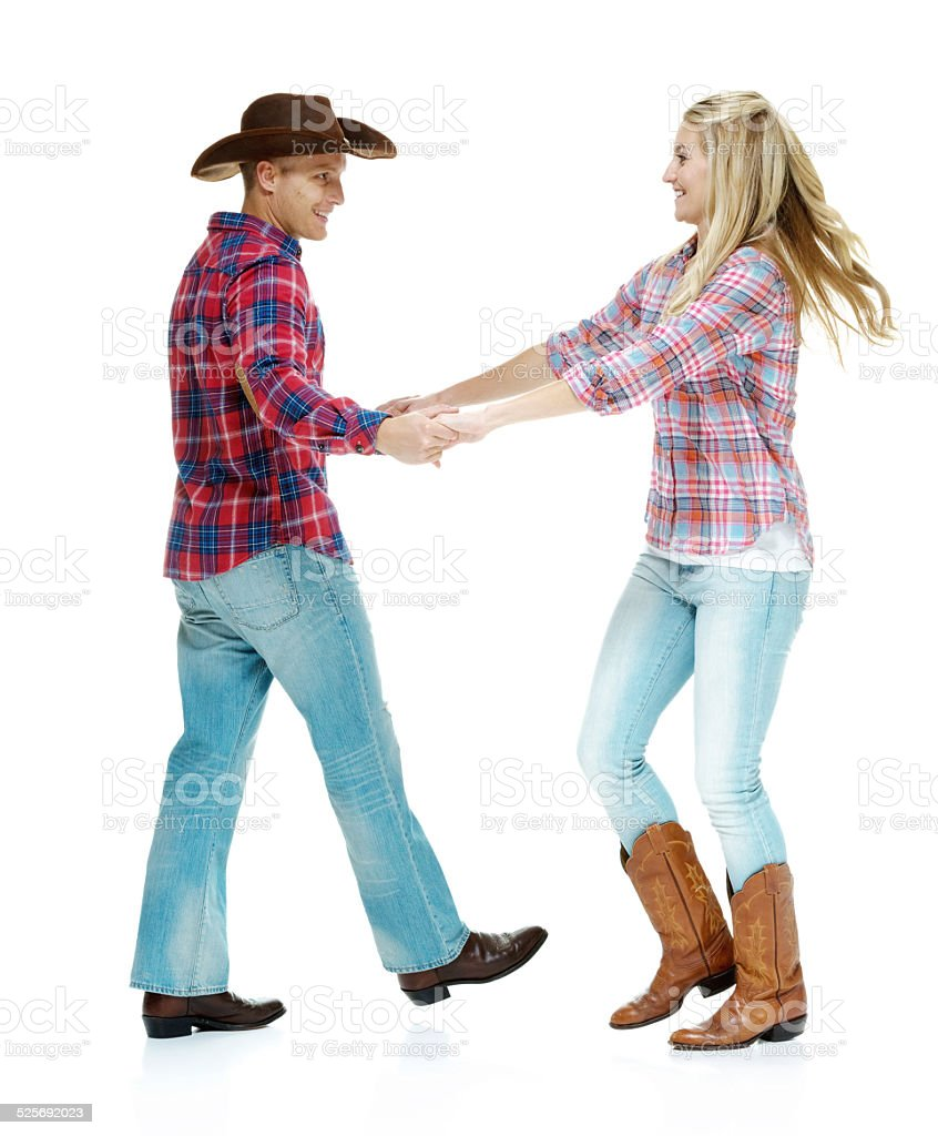 Cheerful cowboy couple dancing stock photo