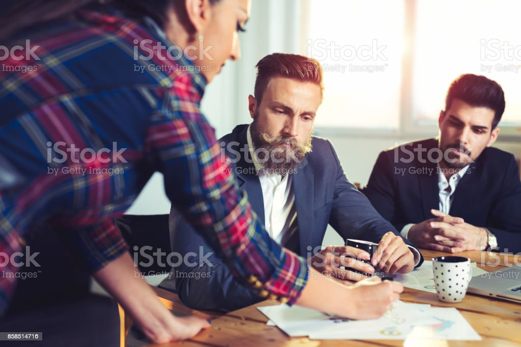 Cheerful coworkers in office during company meeting stock photo