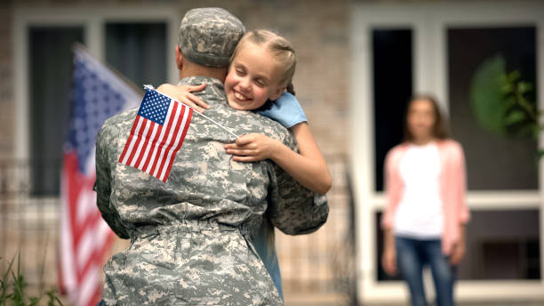 cheerful daughter hugging father soldier, long awaited meeting, homecome - exército imagens e fotografias de stock