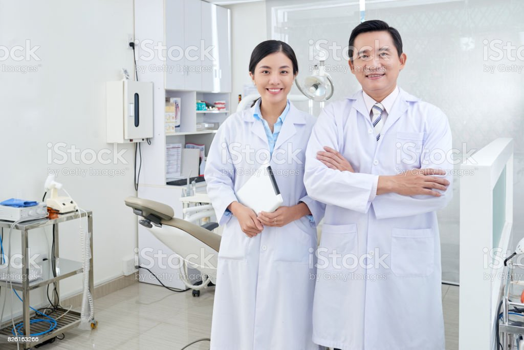 Cheerful dentist and nurse stock photo