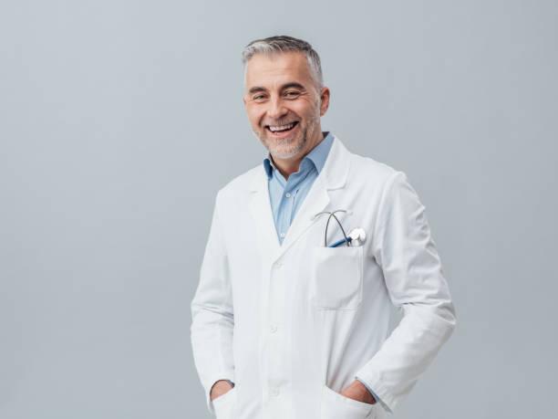 Cheerful doctor posing stock photo