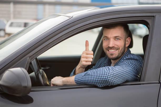 Cheerful driver stock photo