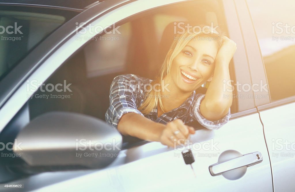 Cheerful driver with new car. stock photo