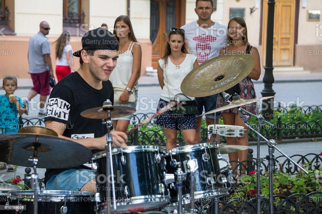 Cheerful drummer stock photo