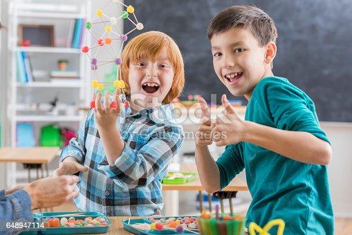 648947070 istock photo Cheerful elementary school boys give thumbs up 648947114