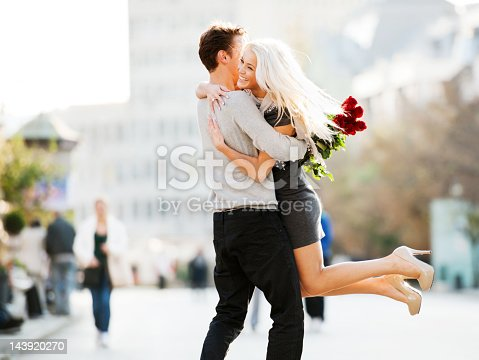 Man giving his girlfriend flowers for Valentine's Day.