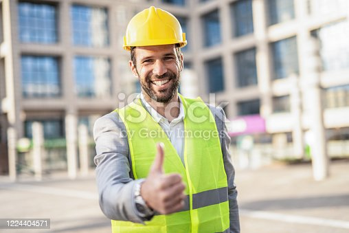 Happy male Mid Adult Architect \ Engineer looking at camera and showing thumb up. Ready for work.