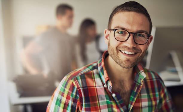 Cheerful entrepreneur wearing glasses in the office stock photo