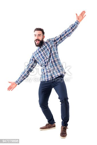 istock Cheerful excited bearded business man with open arms welcoming hugging gesture. 947279898