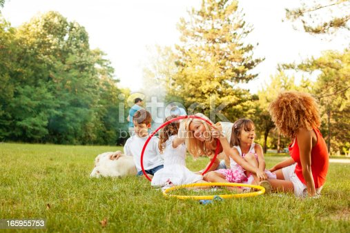 istock Cheerful Families barbecue outdoors. 165955753