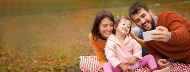 Cheerful family doing selfie outdoor picture id1173403001?b=1&k=6&m=1173403001&s=612x612&w=0&h=x9u3j3093xzuzfrbnzsyadoqwuhtruzvlpxahhy gdy=