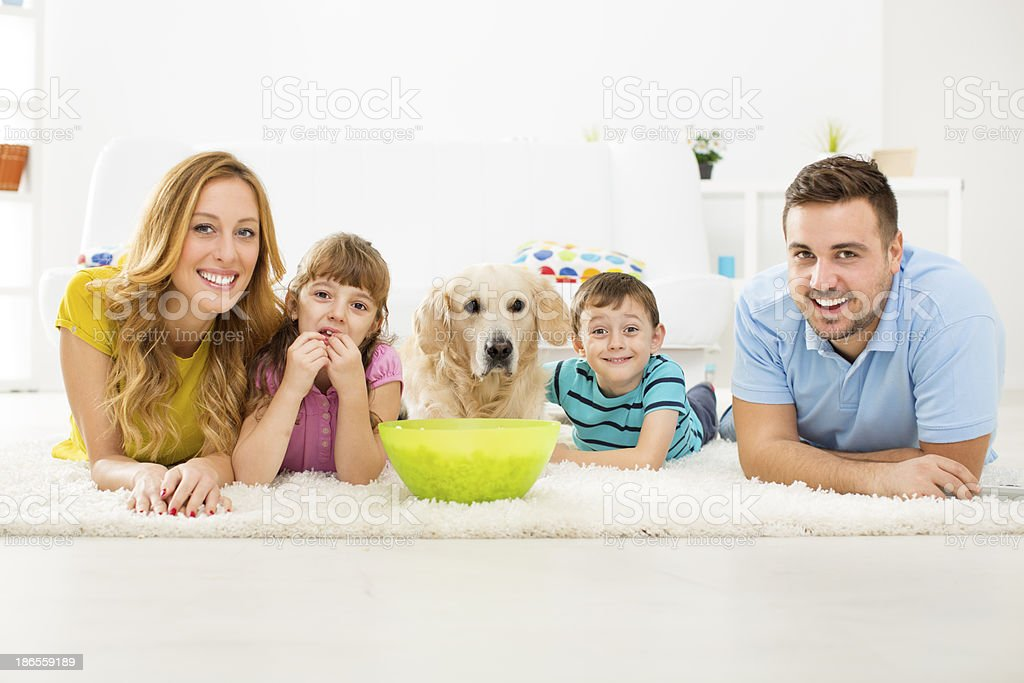 Cheerful Family Eating Popcorns and Watching TV. royalty-free stock photo