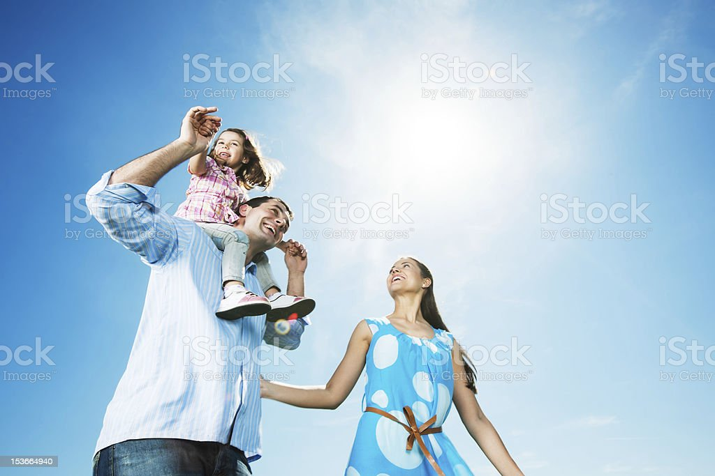 Cheerful family enjoying together outside. stock photo
