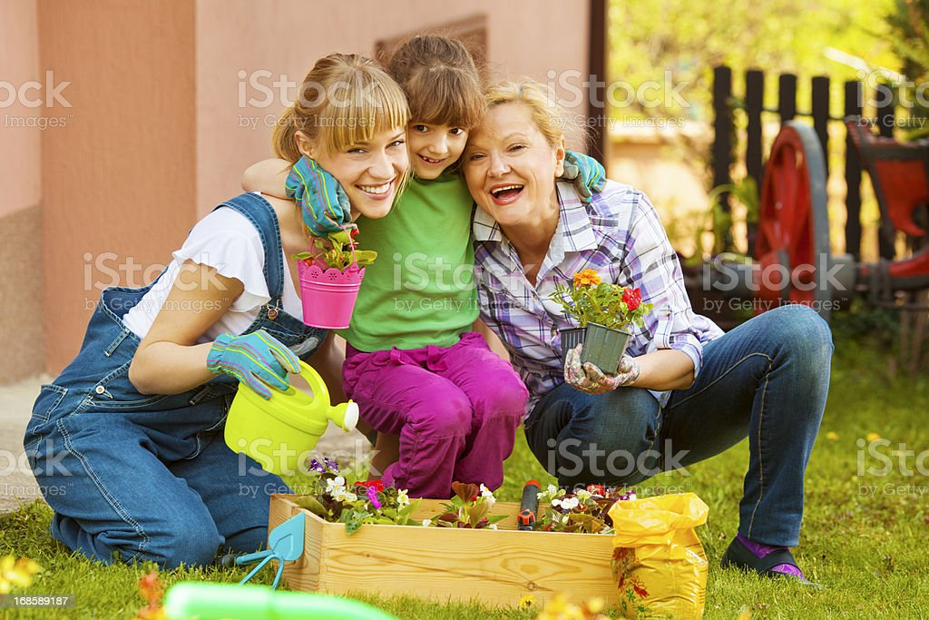 Cheerful Family Gardening Together Outdoors royalty-free stock photo