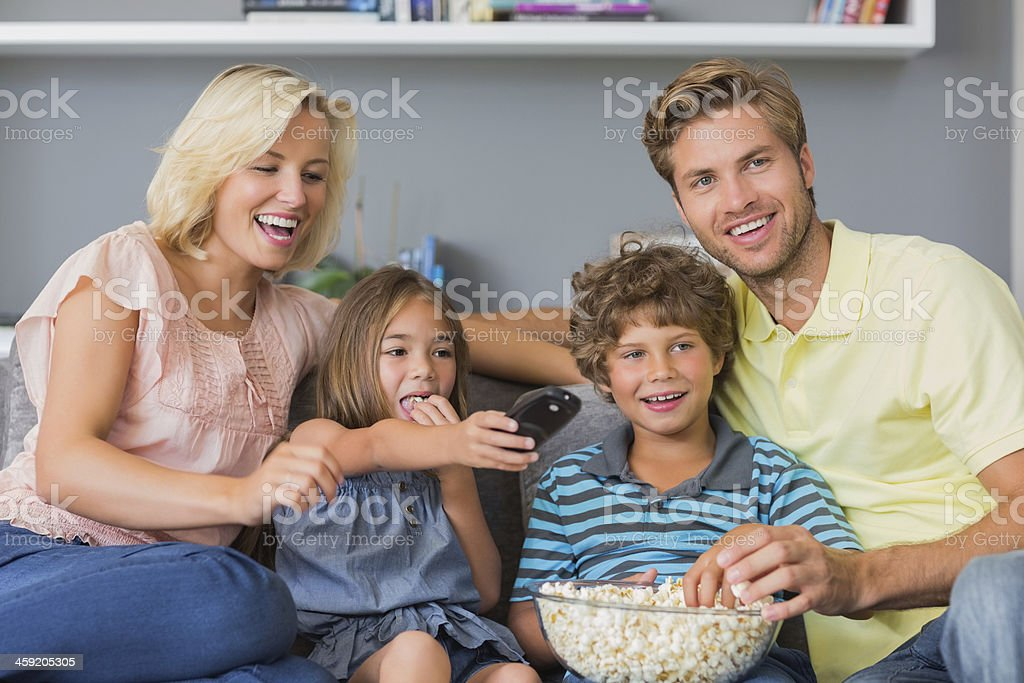 Cheerful family looking at the television royalty-free stock photo