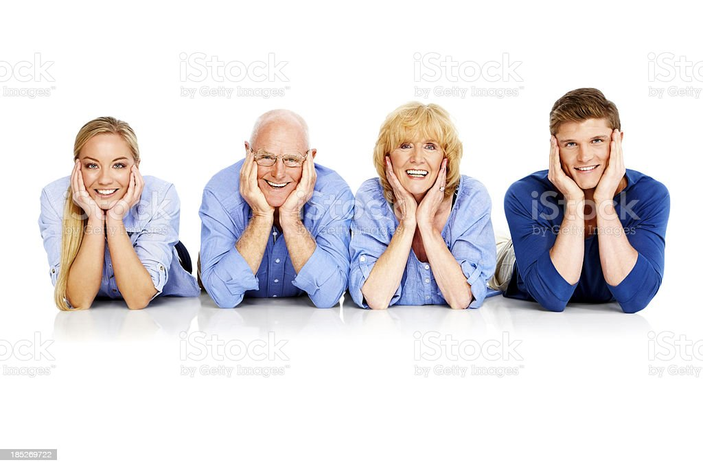 Cheerful family lying on the floor royalty-free stock photo