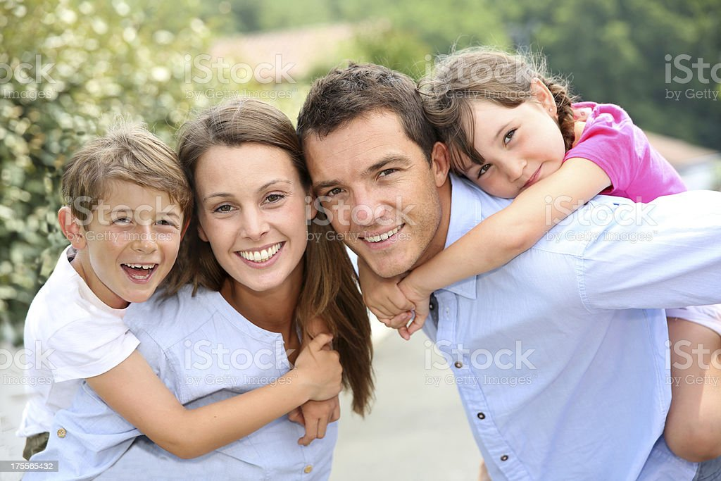 Cheerful family of four smiling at camera royalty-free stock photo