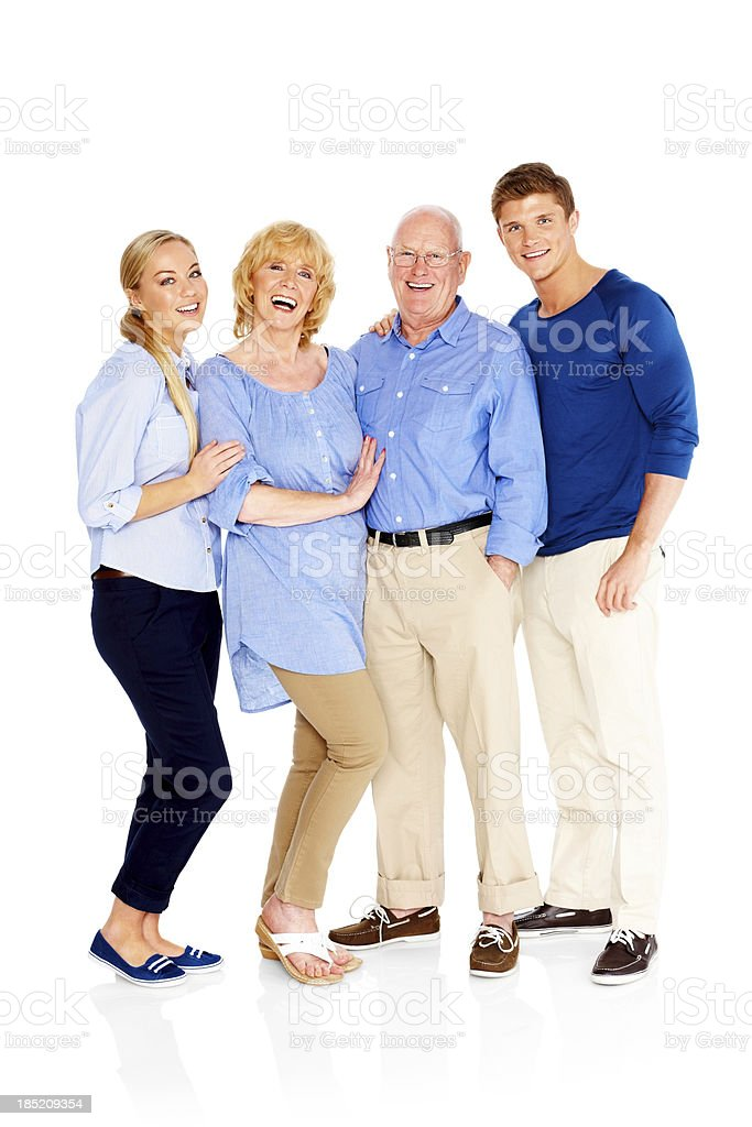 Cheerful family of four standing together on white royalty-free stock photo