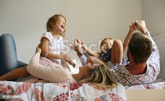 istock Cheerful family. 613548866