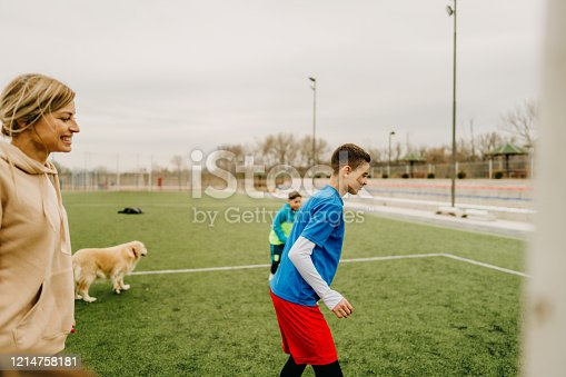 829627936 istock photo Cheerful family playing soccer together 1214758181