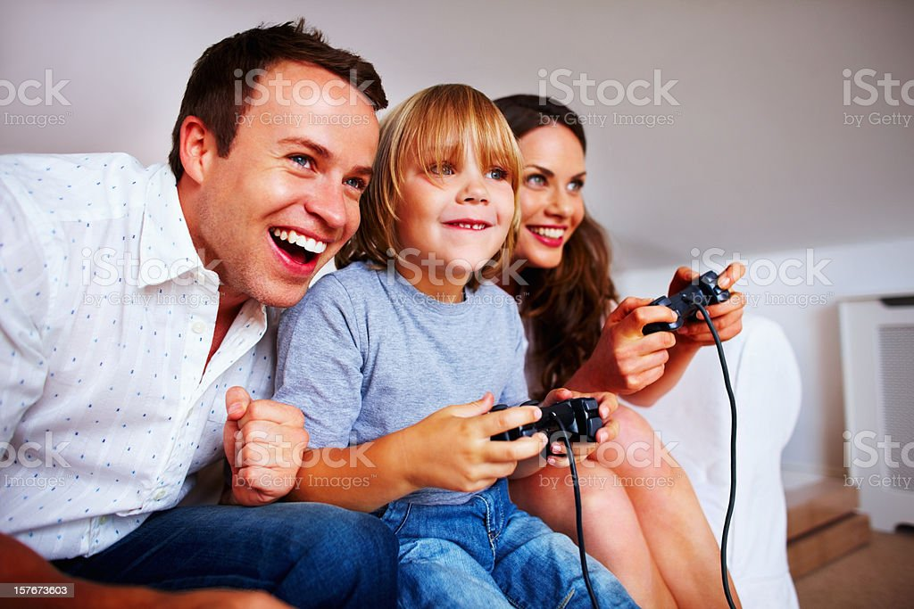 Cheerful family playing video game at home royalty-free stock photo