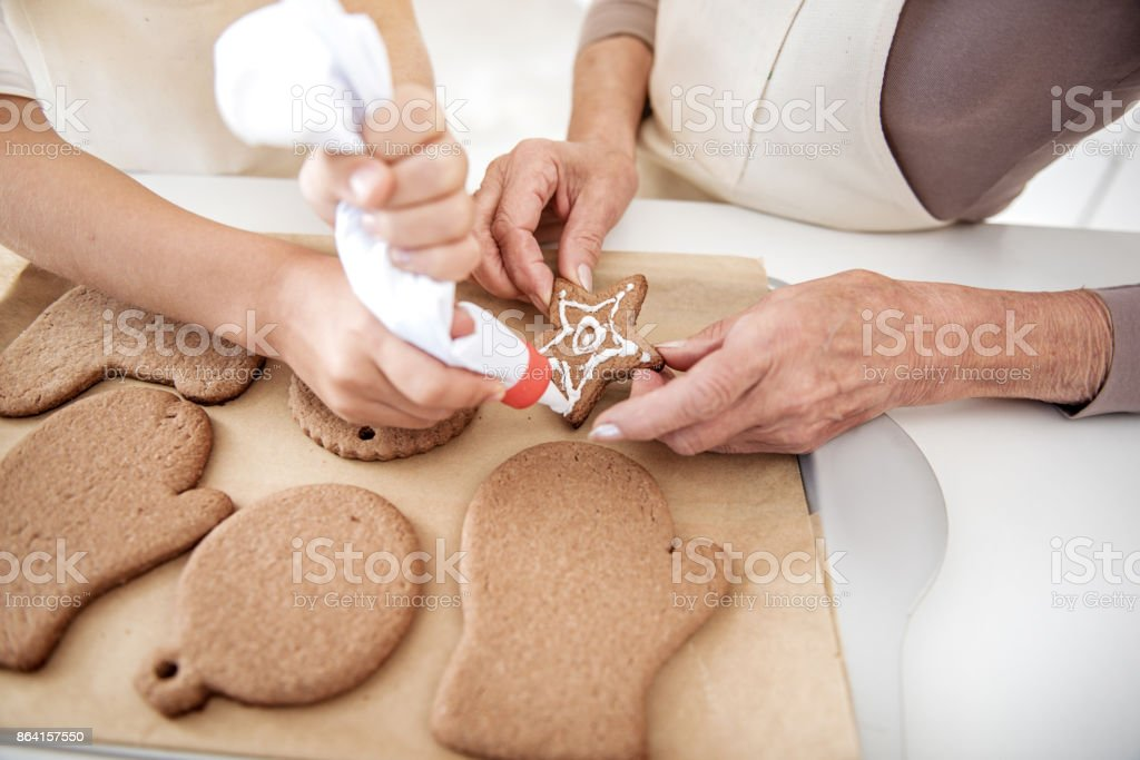 Cheerful family preparing Christmas cookies royalty-free stock photo