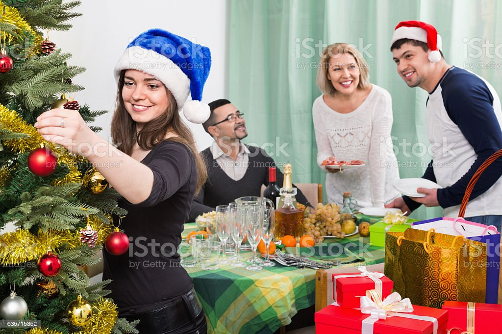 Cheerful  family setting table for dinner royalty-free stock photo