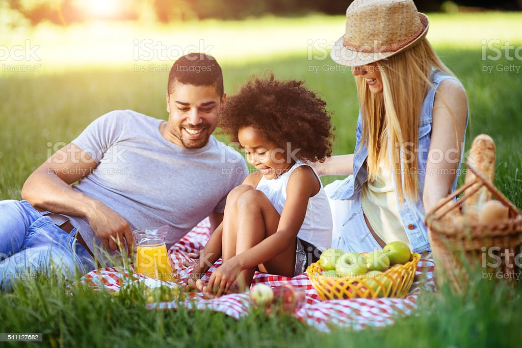 Cheerful family spending time together stock photo