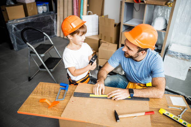 Cheerful family using tools in workshop stock photo stock photo