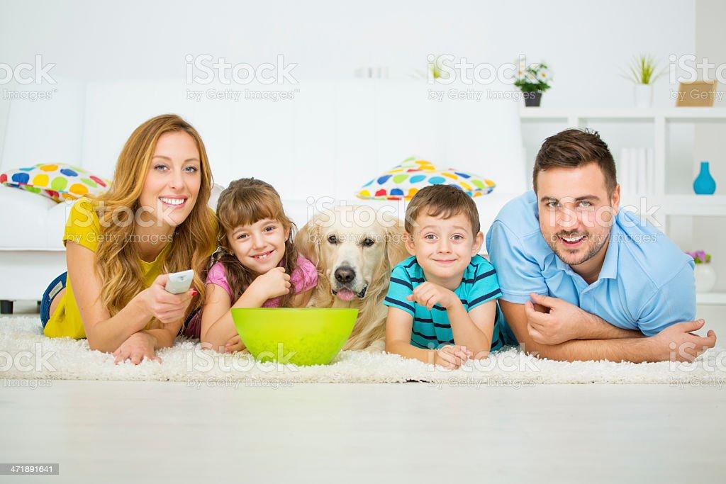 Cheerful Family Watching TV. stock photo