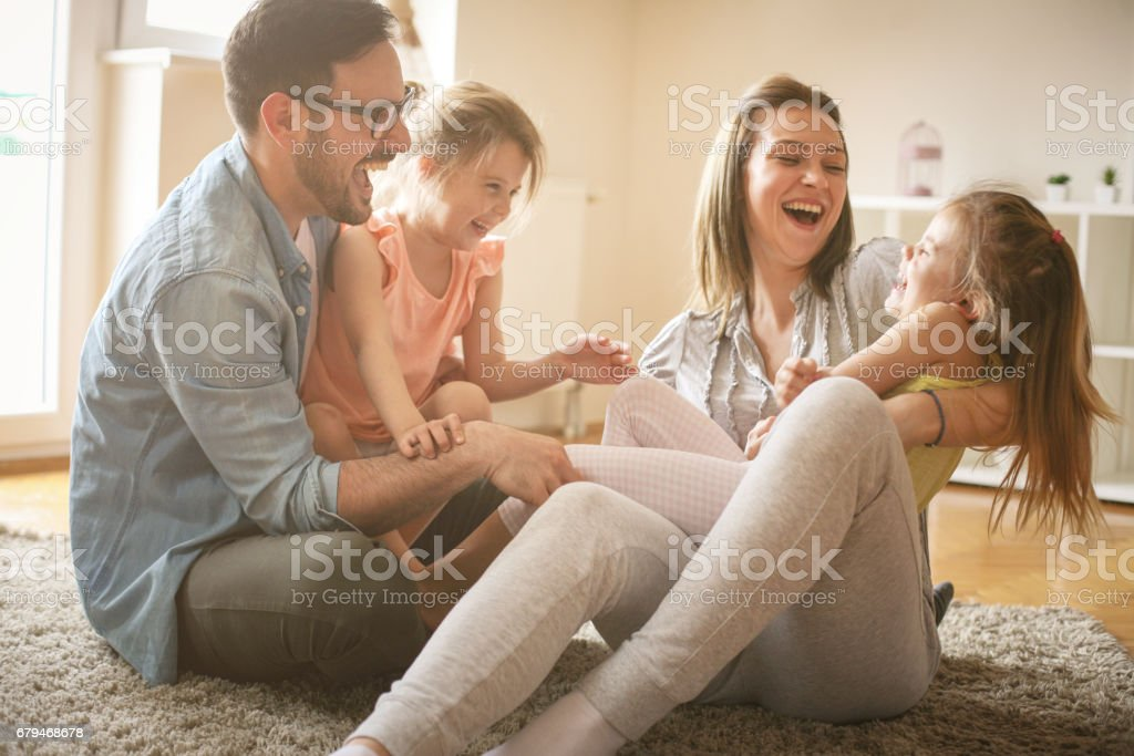 Cheerful family with two child spending time at home. royalty-free stock photo