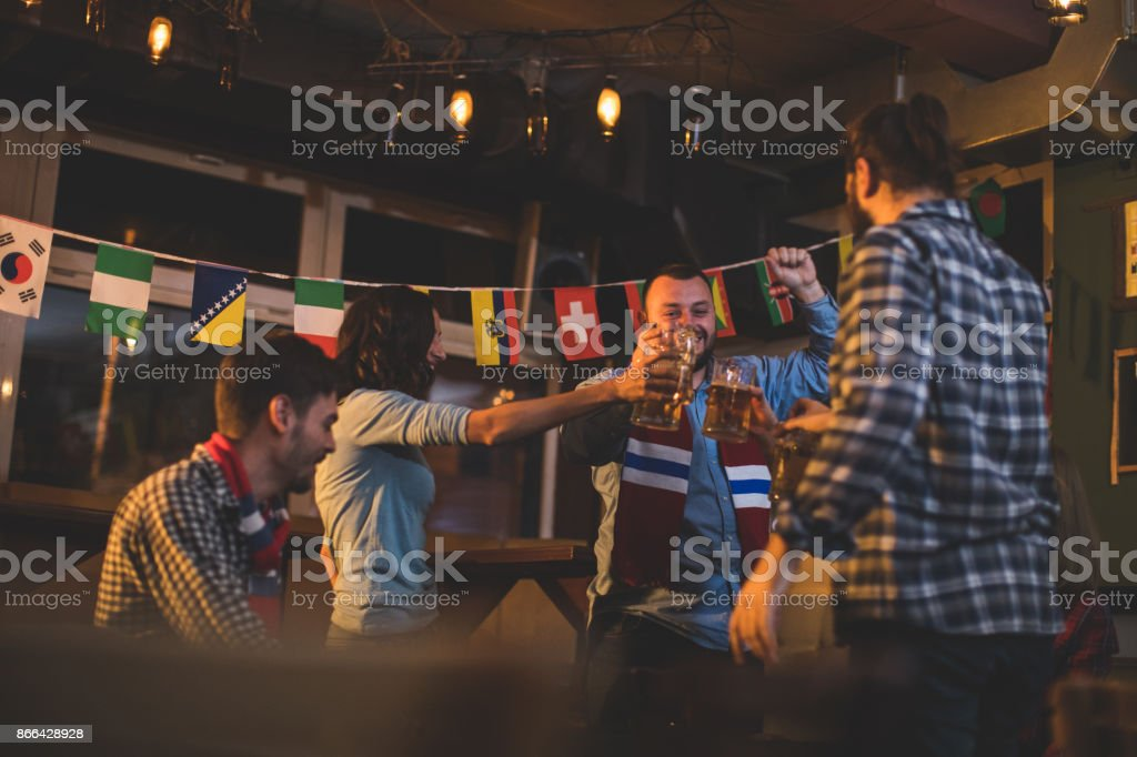 Cheerful fans in pub stock photo