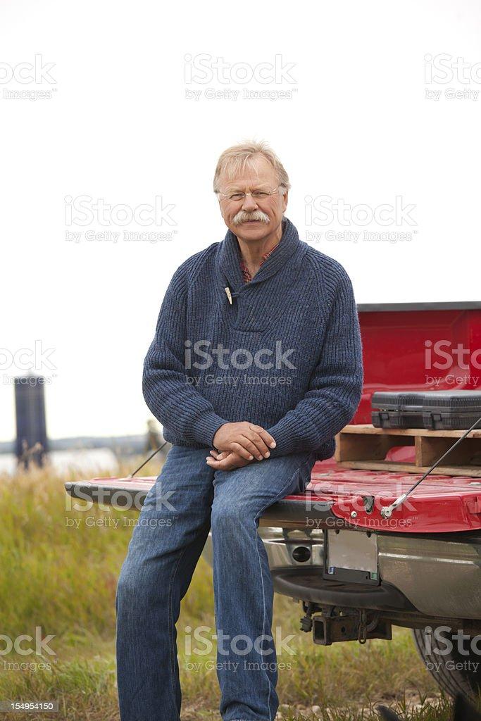 Cheerful Farmer With Truck on Farm royalty-free stock photo