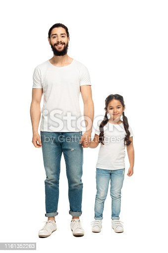 cheerful father holding hands with cute daughter isolated on white